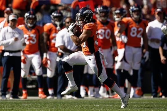 Sep 16, 2018; Denver, CO, USA; Denver Broncos running back Phillip Lindsay (30) runs the ball in the second quarter against the Oakland Raiders at Broncos Stadium at Mile High. Mandatory Credit: Isaiah J. Downing-USA TODAY Sports