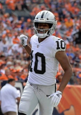 Sep 16, 2018; Denver, CO, USA; Oakland Raiders wide receiver Seth Roberts (10) celebrates his touchdown catch against the Denver Broncos in the third quarter at Broncos Stadium at Mile High. Mandatory Credit: Kirby Lee-USA TODAY Sports