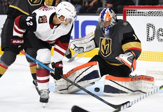 Sep 16, 2018; Las Vegas, NV, USA; Vegas Golden Knights goaltender Dylan Ferguson (1) stops a shot by Arizona Coyotes left wing David Ullstrom (42) during the first period  T-Mobile Arena. Mandatory Credit: Stephen R. Sylvanie-USA TODAY Sports