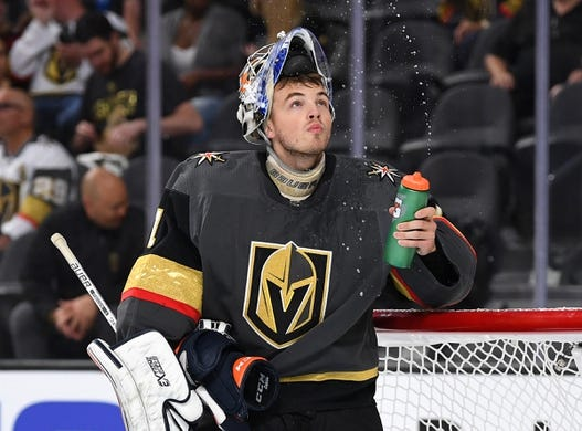 Sep 16, 2018; Las Vegas, NV, USA; Vegas Golden Knights goaltender Dylan Ferguson (1) squirts his water bottle during the first period against the Arizona Coyotes at T-Mobile Arena. Mandatory Credit: Stephen R. Sylvanie-USA TODAY Sports