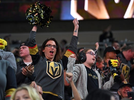 Sep 16, 2018; Las Vegas, NV, USA; Vegas Golden Knights fans celebrate a first period goal scored against the Arizona Coyotes at T-Mobile Arena. Mandatory Credit: Stephen R. Sylvanie-USA TODAY Sports