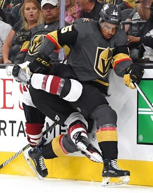 Sep 16, 2018; Las Vegas, NV, USA; Arizona Coyotes defenseman Hudson Wilson (82) gets tangled up with Vegas Golden Knights right wing Keegan Kolesar (55) along the boards during the second period at T-Mobile Arena. Mandatory Credit: Stephen R. Sylvanie-USA TODAY Sports