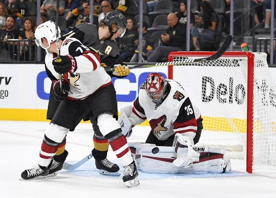 Sep 16, 2018; Las Vegas, NV, USA; Arizona Coyotes goaltender Darcy Kuemper (35) makes a second period save against Vegas Golden Knights center William Karlsson (71) at T-Mobile Arena. Mandatory Credit: Stephen R. Sylvanie-USA TODAY Sports