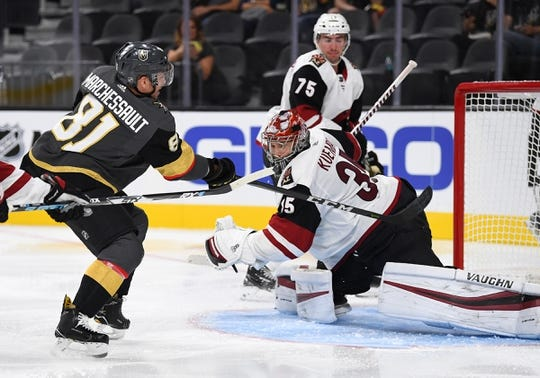 Sep 16, 2018; Las Vegas, NV, USA; Vegas Golden Knights center Jonathan Marchessault (81) scores a second period goal against Arizona Coyotes goaltender Darcy Kuemper (35) at T-Mobile Arena. Mandatory Credit: Stephen R. Sylvanie-USA TODAY Sports