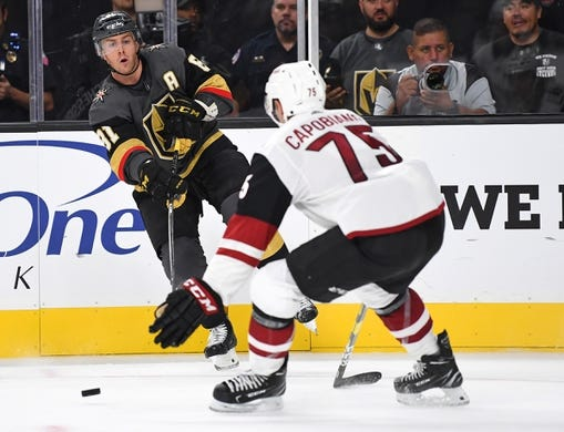 Sep 16, 2018; Las Vegas, NV, USA; Vegas Golden Knights center Jonathan Marchessault (81) passes the puck away from Arizona Coyotes defenseman Kyle Capobianco (75) during the second period at T-Mobile Arena. Mandatory Credit: Stephen R. Sylvanie-USA TODAY Sports