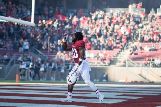 August 31, 2018; Stanford, CA, USA; Stanford Cardinal running back Bryce Love (20) prays in the endzone before the game against the San Diego State Aztecs at Stanford Stadium. Mandatory Credit: Kyle Terada-USA TODAY Sports