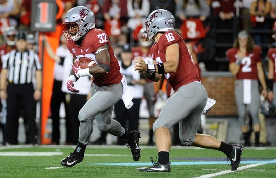 Sep 8, 2018; Pullman, WA, USA; Washington State Cougars running back James Williams (32) takes the hand off from Washington State Cougars quarterback Gardner Minshew (16) during a football game against the San Jose State Spartans in the first half at Martin Stadium. Mandatory Credit: James Snook-USA TODAY Sports