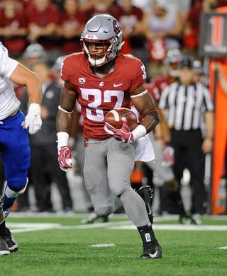Sep 8, 2018; Pullman, WA, USA; Washington State Cougars running back James Williams (32) runs the football during a football game against the San Jose State Spartans in the first half at Martin Stadium. Mandatory Credit: James Snook-USA TODAY Sports