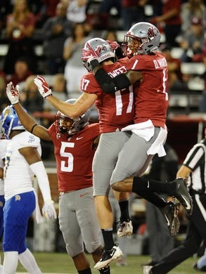 Sep 8, 2018; Pullman, WA, USA; Washington State Cougars wide receiver Davontavean Martin (1) celebrates a touchdown with Washington State Cougars wide receiver Kyle Sweet (17) against the San Jose State Spartans during the first half at Martin Stadium. Mandatory Credit: James Snook-USA TODAY Sports