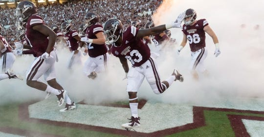 Sep 15, 2018; Starkville, MS, USA; The Mississippi State Bulldogs rush onto the field before the first half at Davis Wade Stadium. Mandatory Credit: Vasha Hunt-USA TODAY Sports