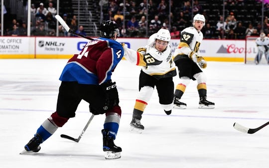 Sep 18, 2018; Denver, CO, USA; Vegas Golden Knights defenseman Erik Brannstrom (12) attempts on goal in the first period during a preseason game against the Colorado Avalanche at the Pepsi Center. Mandatory Credit: Ron Chenoy-USA TODAY Sports
