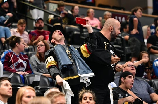 Sep 18, 2018; Denver, CO, USA; Vegas Golden Knights fans cheer following a goal by Brandon Pirri (73) (not pictured) in the first period during a preseason game against the Colorado Avalanche at the Pepsi Center. Mandatory Credit: Ron Chenoy-USA TODAY Sports