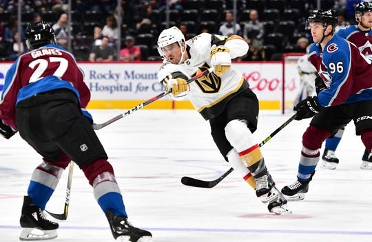Sep 18, 2018; Denver, CO, USA; Vegas Golden Knights center Ryan Carpenter (40) attempts a shot on goal in the first period during a preseason game against the Colorado Avalanche at the Pepsi Center. Mandatory Credit: Ron Chenoy-USA TODAY Sports