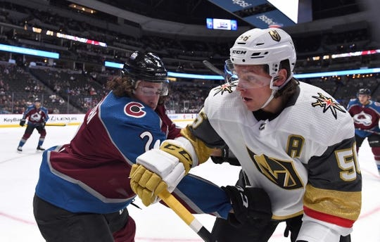 Sep 18, 2018; Denver, CO, USA; Colorado Avalanche defenseman Mason Geertsen (2) and Vegas Golden Knights left wing Erik Haula (56) battle for the puck in the first period during a preseason game at the Pepsi Center. Mandatory Credit: Ron Chenoy-USA TODAY Sports