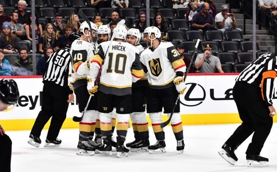 Sep 18, 2018; Denver, CO, USA; Vegas Golden Knights center Brandon Pirri (73) (second left) celebrates scoring a goal with center Ryan Carpenter (40) and center Brooks Macek (10) and goaltender Malcolm Subban (30) defenseman Erik Brannstrom (12) in the first period during a preseason game at the Pepsi Center. Mandatory Credit: Ron Chenoy-USA TODAY Sports