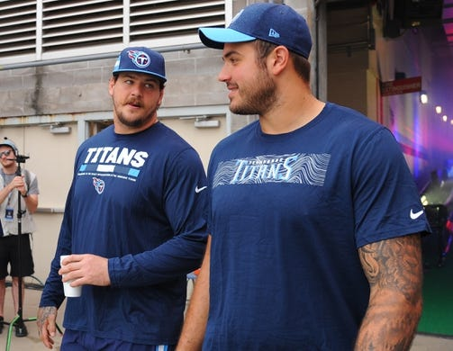Sep 16, 2018; Nashville, TN, USA; Tennessee Titans offensive tackle Taylor Lewan (left) and Tennessee Titans offensive tackle Jack Conklin (right) before the game against the Houston Texans at Nissan Stadium. Mandatory Credit: Christopher Hanewinckel-USA TODAY Sports