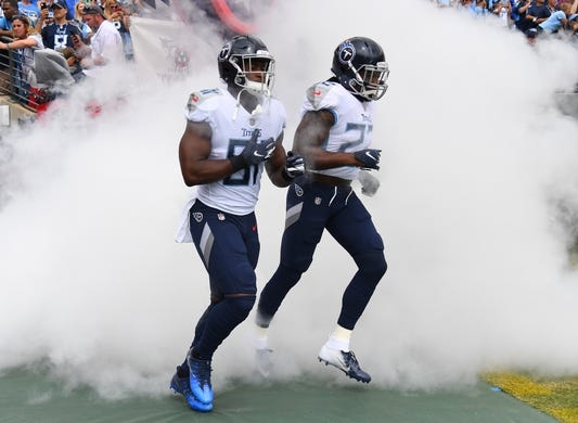 Sep 16, 2018; Nashville, TN, USA; Tennessee Titans tight end Jonnu Smith (81) and Tennessee Titans running back Derrick Henry (22) take the field before the game against the Houston Texans at Nissan Stadium. Mandatory Credit: Christopher Hanewinckel-USA TODAY Sports
