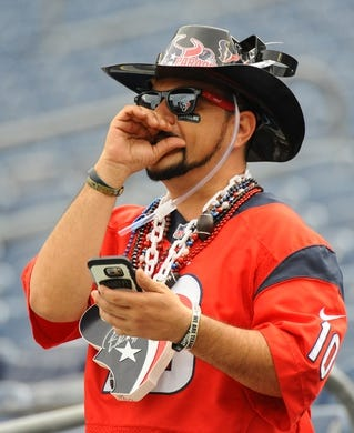 Sep 16, 2018; Nashville, TN, USA; A Houston Texans fan cheers before the game against the Tennessee Titans at Nissan Stadium. Mandatory Credit: Christopher Hanewinckel-USA TODAY Sports