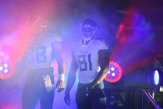 Sep 16, 2018; Nashville, TN, USA; Tennessee Titans tight end Luke Stocker (88) and Tennessee Titans tight end Jonnu Smith (81) walk down the tunnel before taking the field for the game against the Houston Texans at Nissan Stadium. Mandatory Credit: Christopher Hanewinckel-USA TODAY Sports