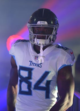 Sep 16, 2018; Nashville, TN, USA; Tennessee Titans wide receiver Corey Davis (84) walks down the tunnel before taking the field for the game against the Houston Texans at Nissan Stadium. Mandatory Credit: Christopher Hanewinckel-USA TODAY Sports