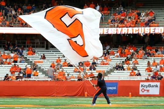 Sep 15, 2018; Syracuse, NY, USA; A Syracuse Orange cheerleader waves a flag on the field prior to the game against the Florida State Seminoles at the Carrier Dome. Mandatory Credit: Rich Barnes-USA TODAY Sports