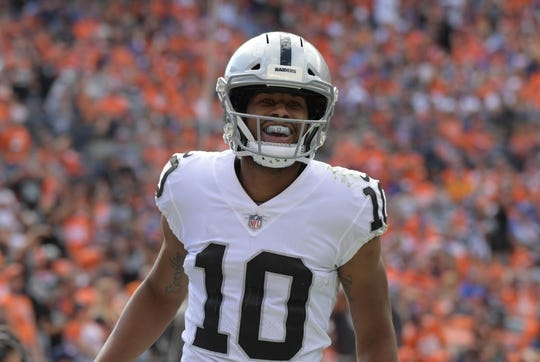 Sep 16, 2018; Denver, CO, USA; Oakland Raiders wide receiver Seth Roberts (10) celebrates after scoring on a 20-yard touchdown reception against the Denver Broncos in the third quarter at Broncos Stadium at Mile High. Mandatory Credit: Kirby Lee-USA TODAY Sports