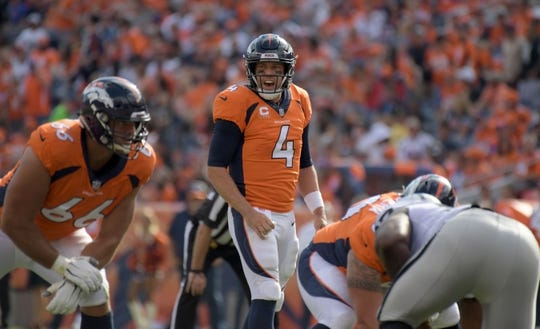 Sep 16, 2018; Denver, CO, USA; Denver Broncos quarterback Case Keenum (4) prepares to take the snap against the Oakland Raiders in the third quarter at Broncos Stadium at Mile High. Mandatory Credit: Kirby Lee-USA TODAY Sports