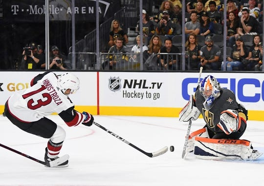 Sep 16, 2018; Las Vegas, NV, USA; Vegas Golden Knights goaltender Dylan Ferguson (1) makes a save on a first period breakaway by Arizona Coyotes center Vinnie Hinostroza (13) at T-Mobile Arena. Mandatory Credit: Stephen R. Sylvanie-USA TODAY Sports