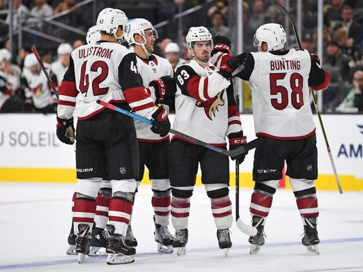 Sep 16, 2018; Las Vegas, NV, USA; Arizona Coyotes players come together to celebrate a goal scored by defenseman Jordan Oesterle (82) during the first period against the Vegas Golden Knights at T-Mobile Arena. Mandatory Credit: Stephen R. Sylvanie-USA TODAY Sports