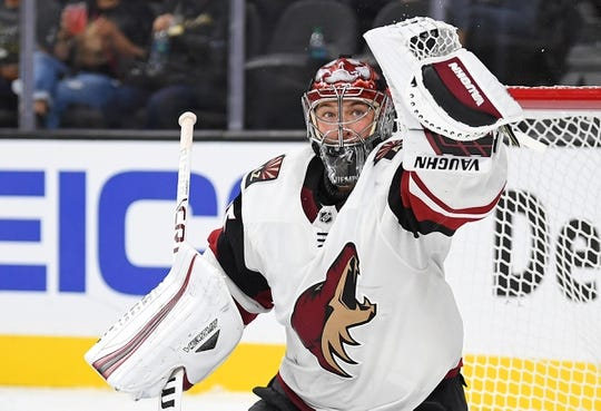 Sep 16, 2018; Las Vegas, NV, USA; Arizona Coyotes goaltender Darcy Kuemper (35) makes a second period glove save against the Vegas Golden Knights at T-Mobile Arena. Mandatory Credit: Stephen R. Sylvanie-USA TODAY Sports