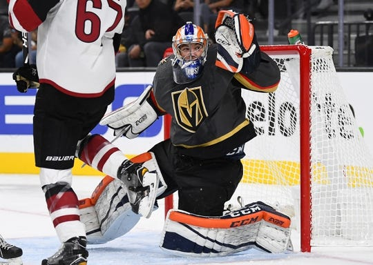 Sep 16, 2018; Las Vegas, NV, USA; Vegas Golden Knights goaltender Dylan Ferguson (1) deflects a first period shot during a pre-season game against the Arizona Coyotes at T-Mobile Arena. Mandatory Credit: Stephen R. Sylvanie-USA TODAY Sports