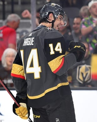 Sep 16, 2018; Las Vegas, NV, USA; Vegas Golden Knights defenseman Nicolas Hague (14) celebrates after scoring a second period goal against the Arizona Coyotes at T-Mobile Arena. Mandatory Credit: Stephen R. Sylvanie-USA TODAY Sports