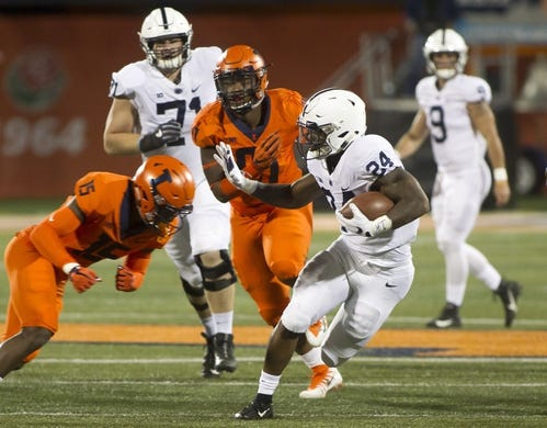 Sep 21, 2018; Champaign, IL, USA; Illinois Fighting Illini defensive back Delano Ware (15) tackles Penn State Nittany Lions running back Miles Sanders (24) during the first quarter at Memorial Stadium. Mandatory Credit: Mike Granse-USA TODAY Sports