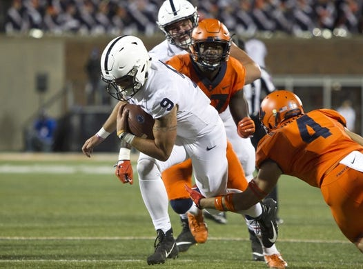 Sep 21, 2018; Champaign, IL, USA; Penn State Nittany Lions quarterback Trace McSorley (9) is tackled by Illinois Fighting Illini defensive back Bennett Williams (4) during the second quarter at Memorial Stadium. Mandatory Credit: Mike Granse-USA TODAY Sports