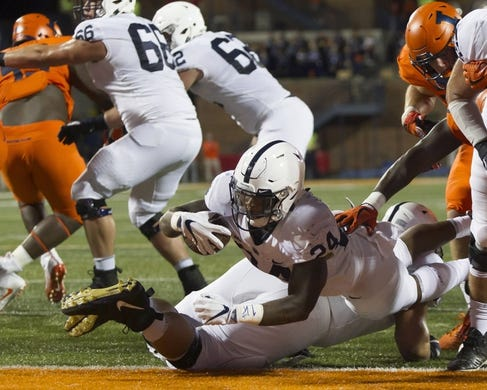 Sep 21, 2018; Champaign, IL, USA; Penn State Nittany Lions running back Miles Sanders (24) scores a touchdown against the Illinois Fighting Illini during the second quarter at Memorial Stadium. Mandatory Credit: Mike Granse-USA TODAY Sports