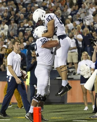 Sep 21, 2018; Champaign, IL, USA; Penn State Nittany Lions offensive lineman Ryan Bates (52) celebrates with tight end Pat Freiermuth (87) after a touchdown during the second quarter at Memorial Stadium. Mandatory Credit: Mike Granse-USA TODAY Sports