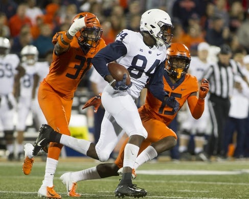 Sep 21, 2018; Champaign, IL, USA; Penn State Nittany Lions wide receiver Juwan Johnson (84) is pursued by Illinois Fighting Illini defensive back Cameron Watkins (31) and defensive back Delano Ware (15) during the second quarter at Memorial Stadium. Mandatory Credit: Mike Granse-USA TODAY Sports