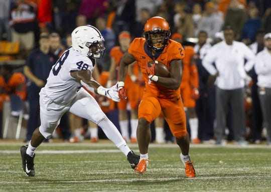 Sep 21, 2018; Champaign, IL, USA; Illinois Fighting Illini running back Reggie Corbin (2) eludes Penn State Nittany Lions defensive end Shareef Miller (48) during the second quarter at Memorial Stadium. Mandatory Credit: Mike Granse-USA TODAY Sports
