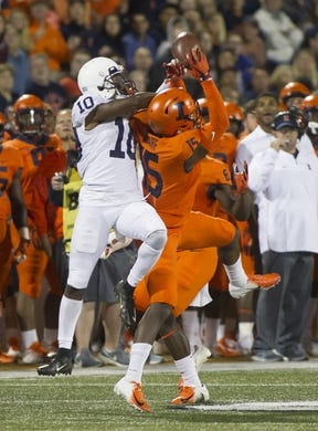Sep 21, 2018; Champaign, IL, USA; Illinois Fighting Illini defensive back Delano Ware (15) intercepts a pass intended for Penn State Nittany Lions wide receiver Brandon Polk (10) during the second quarter at Memorial Stadium. Mandatory Credit: Mike Granse-USA TODAY Sports