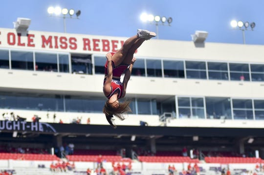 Sep 22, 2018; Oxford, MS, USA; A Mississippi Rebels cheerleader performs before the game against the Kent State Golden Flashes at Vaught-Hemingway Stadium. Mandatory Credit: Matt Bush-USA TODAY Sports