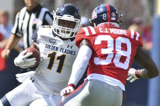 Sep 22, 2018; Oxford, MS, USA; Kent State Golden Flashes running back Justin Rankin (11) runs the ball as he is defended by Mississippi Rebels defensive back C.J. Moore (38) during the first quarter at Vaught-Hemingway Stadium. Mandatory Credit: Matt Bush-USA TODAY Sports