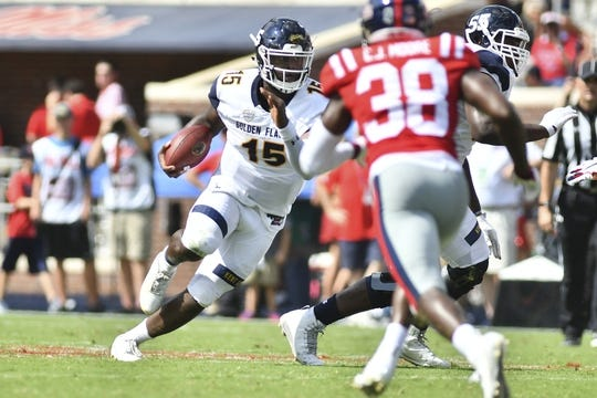 Sep 22, 2018; Oxford, MS, USA; Kent State Golden Flashes quarterback Woody Barrett (15) runs the ball against the Mississippi Rebels during the first quarter at Vaught-Hemingway Stadium. Mandatory Credit: Matt Bush-USA TODAY Sports