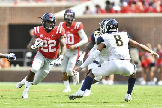 Sep 22, 2018; Oxford, MS, USA; Mississippi Rebels running back Scottie Phillips (22) runs the ball while he is defended by Kent State Golden Flashes safety Elvis Hines (8) during the first quarter at Vaught-Hemingway Stadium. Mandatory Credit: Matt Bush-USA TODAY Sports