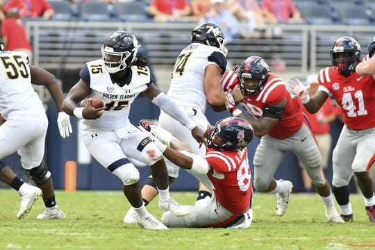 Sep 22, 2018; Oxford, MS, USA; Kent State Golden Flashes quarterback Woody Barrett (15) scrambles as he is defended by Mississippi Rebels defensive end Ryder Anderson (89) during the second quarter at Vaught-Hemingway Stadium. Mandatory Credit: Matt Bush-USA TODAY Sports