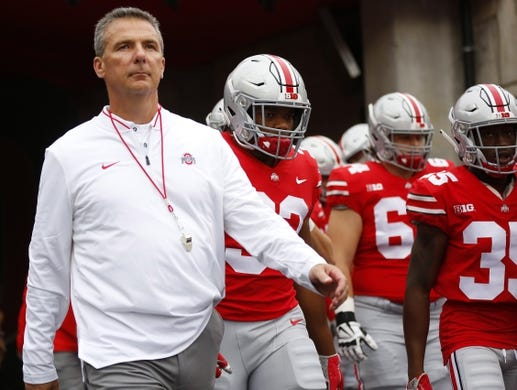 Sep 22, 2018; Columbus, OH, USA; Ohio State Buckeyes head coach Urban Meyer (left) enters the field before the game against the Tulane Green Wave at Ohio Stadium. Mandatory Credit: Joe Maiorana-USA TODAY Sports