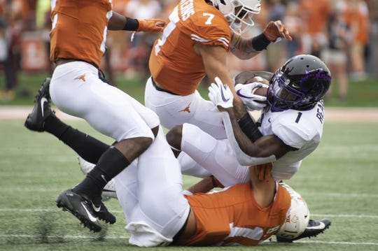 Sep 22, 2018; Austin, TX, USA; Texas Christian Horned Frogs wide receiver Jalen Reagor (1) is tackled by Texas Longhorns defensive back Caden Sterns (7) and defensive back Brandon Jones (19) during the first quarter at Darrell K Royal-Texas Memorial Stadium. Mandatory Credit: Bethany Hocker-USA TODAY Sports