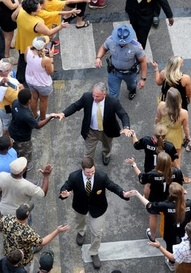 Sep 22, 2018; Hattiesburg, MS, USA; Southern Miss Golden Eagles head coach Jay Hopson, center, greets fans before their game against the Rice Owls at M. M. Roberts Stadium. Mandatory Credit: Chuck Cook-USA TODAY Sports