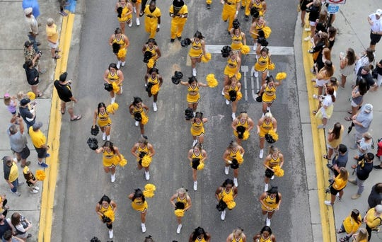 Sep 22, 2018; Hattiesburg, MS, USA; The Southern Miss cheerleaders march in a pre-game parade before the game between the Southern Miss Golden Eagles and the Rice Owls at M. M. Roberts Stadium. Mandatory Credit: Chuck Cook-USA TODAY Sports