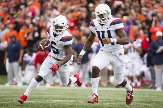 Sep 22, 2018; Corvallis, OR, USA; Arizona Wildcats wide receiver Shun Brown (6) runs for a touchdown during the first half as he is led by quarterback Khalil Tate (14) against the Oregon State Beavers at Reser Stadium. Mandatory Credit: Troy Wayrynen-USA TODAY Sports