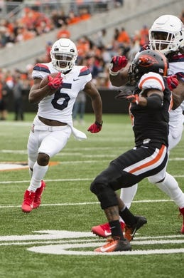 Sep 22, 2018; Corvallis, OR, USA; Arizona Wildcats wide receiver Shun Brown (6) gets a block from a teammate as he scores a touchdown during the first half against the Oregon State Beavers at Reser Stadium. Mandatory Credit: Troy Wayrynen-USA TODAY Sports